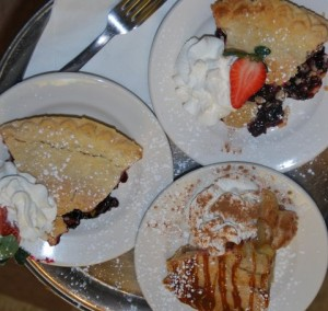 Freshly baked apple and berry pies