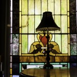 Stainded glass window and lamp close-up by Adam Anderson